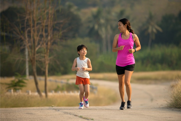 Relax time on summer,Daughter and mother jogging at park, healthy active lifestyle concept