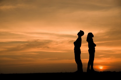 Break Up,Bad relationship,Anger,unhappy, concept.Silhouette of anger of couples love who are quarreling (argument) and standing back to back with sunset background in Thailand.Anger Concept
