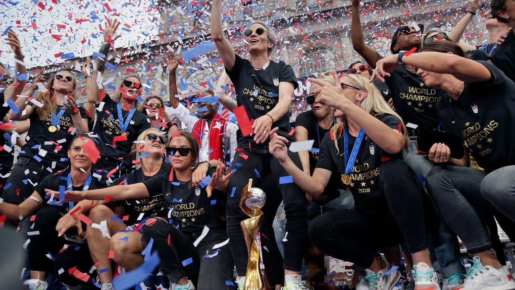 The U.S. women's soccer team, Megan Rapinoe center, celebrates at City Hall after a ticker tape parade, in New York. The U.S. national team beat the Netherlands 2-0 to capture a record fourth Women's World Cup title