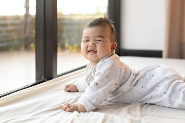 Asian cute baby boy happiness on nature outside window background.