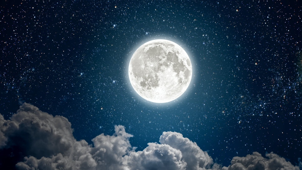 background night sky with stars, moon and clouds. Elements of this image furnished by NASA
