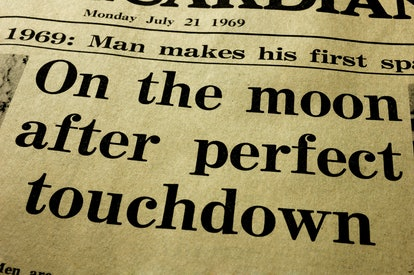 History. Close-up of the headline from a paper, the day after the first man landed on the Moon.