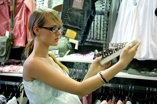 young pregnant woman on shop browsing