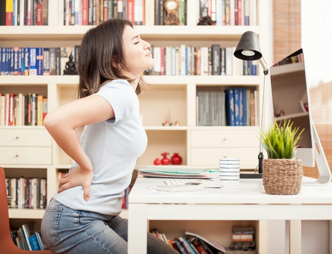 woman sitting and have a back pain