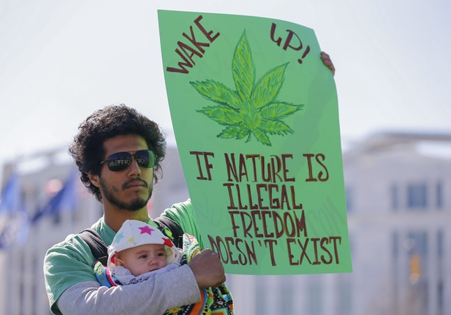 Julio Mijangos Holds His Daughter Kaya and a Sign While Participating in the Pro Marijuana Rally For Peace Justice and Unity Hosted by Peachtree N O R M L National Organization For the Reform of Marijuana Laws Outside the Georgia State Capitol in Atlanta Georgia Usa 10 February 2015 the State Legislature is Considering a Bill to Legalize Cannabis Oil For Certain Medical Conditions But Other Advocates Are Lobbying For the Legalization of Smokable Marijuana in Georgia United States Atlanta