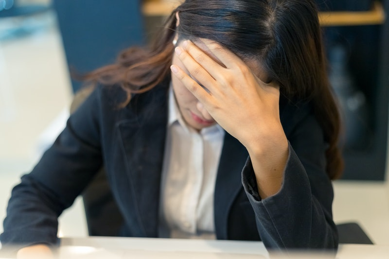 Asian business woman stress from work in the office