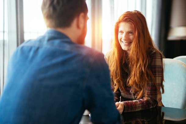 Happy woman on a first date with handsome man showing emotions