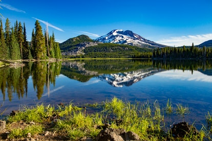a cold morning on sparks lake with the south sister mountain in the background, near Bend, Oregon
