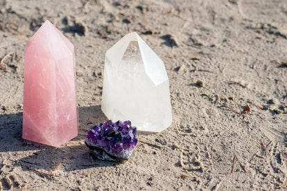 Golden Triangle gemstones: amethyst, rose quartz and white quartz, standing together on the beach