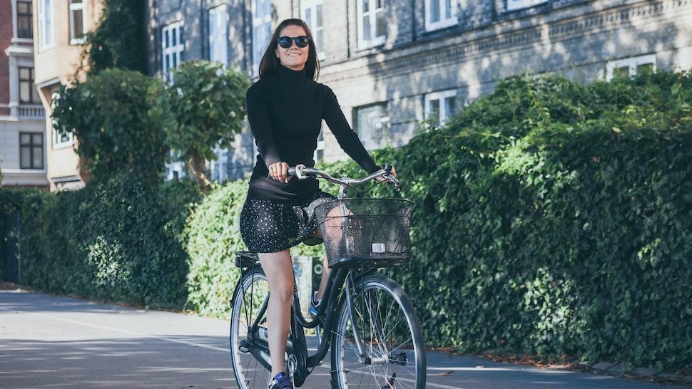 Beautiful woman riding on bike in COPENHAGEN, DENMARK
