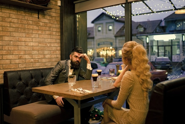 Bad date of couple, break up relations and love. Business meeting of man and woman. Valentines day with woman and man. Dislike makes conflict and divorce. couple with misunderstanding at restaurant