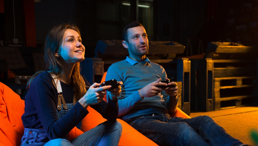 Playing video games while sitting on sofa