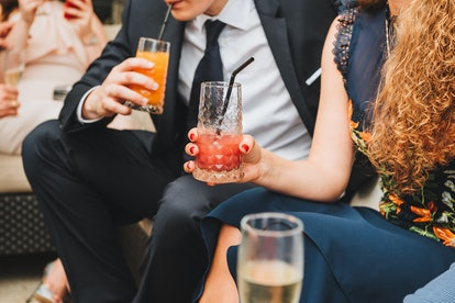 People drinking soft drinks at a social event