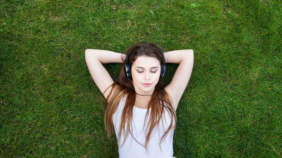 enjoy the music, top view of young woman in headphones, background