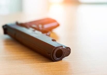 Black gun put on the table.