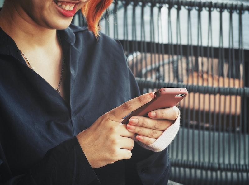 Woman using smart phone on hand