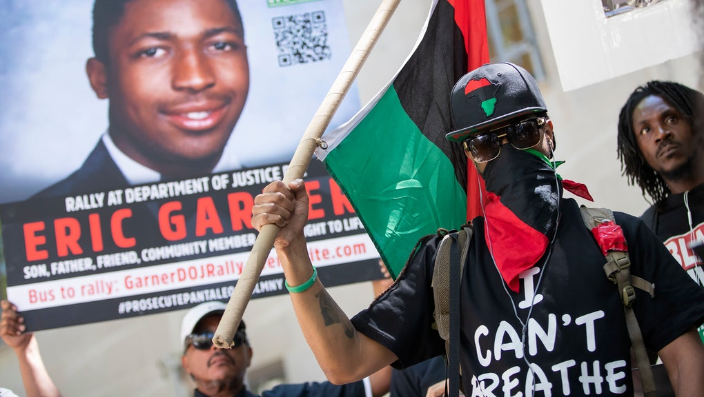 A man covers his face during a Black Lives Matter of Greater New York protest at the US Department of Justice building in support of an indictment for the death of Eric Garner in Washington, DC, USA, 15 July 2019. Eric Garner died 17 July 2014 during a confrontation with officers of the New York City Police Department. The group is calling for NYPD officer Daniel Pantaleo to be charged in Garner's death. The federal statute of limitation in the Garner case expires 17 July 2019.