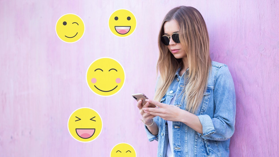 Cute Young Adult Girl Typing  on Smartphone With Variable Yellow Emoticons Sticker Communication Concept