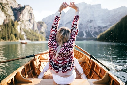 Young beatiful woman on boat