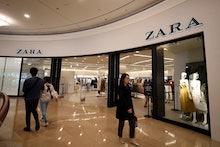 Customers walk past Zara, a Spanish fast fashion retailer store in Taipei, Taiwan, 13 March 2019 (is...