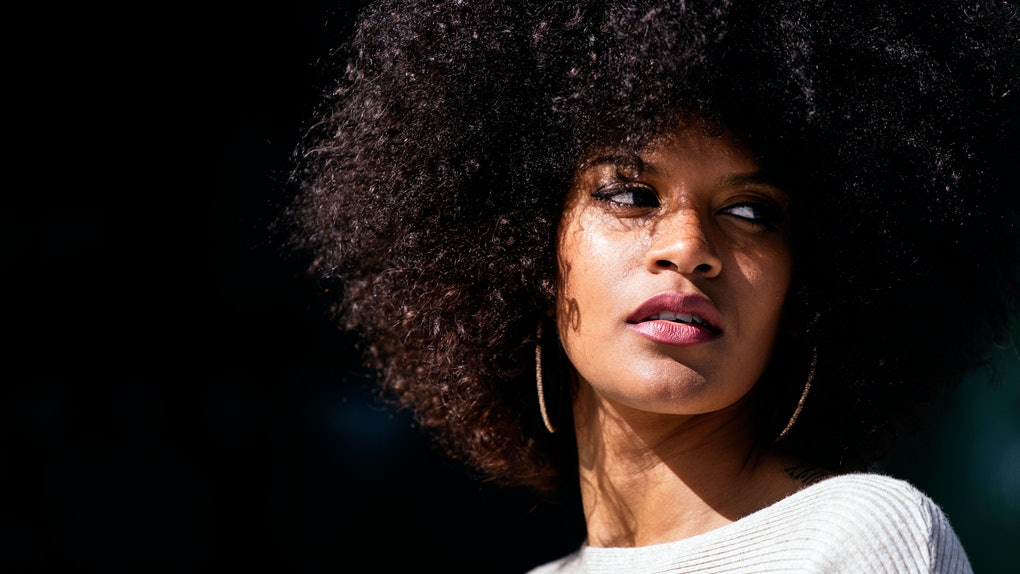 Portrait of attractive afro woman in over the wall. Hair style concept