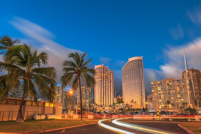 Luxurious hotels overlooking the Ala Wai Harbor at twilight and the light trails in Honolulu, Oahu, Hawaii.