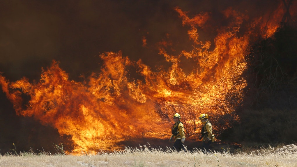 A hillside erupts in flame as a wildfire burns in Placerita Canyon in Santa Clarita, Calif., . The s...