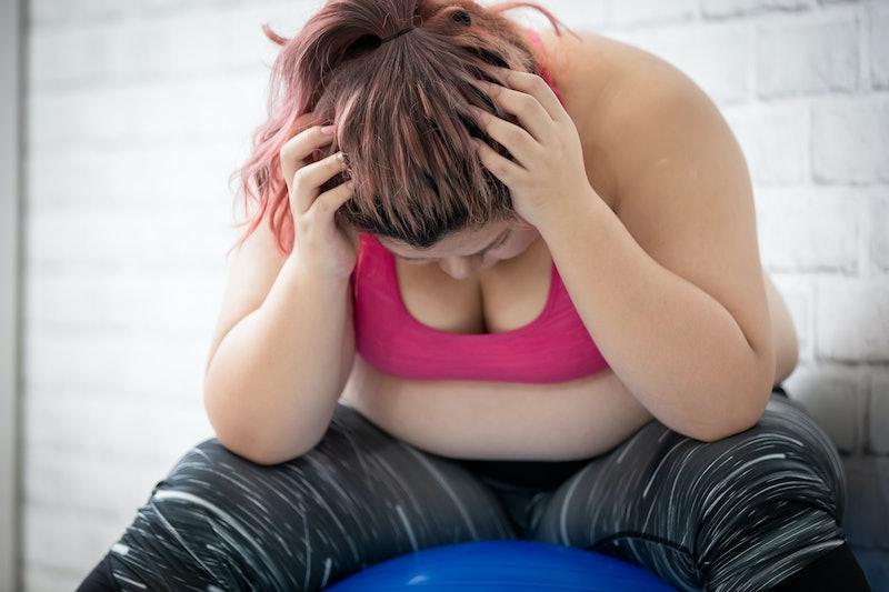 plus size asian girl feel upset when exercising