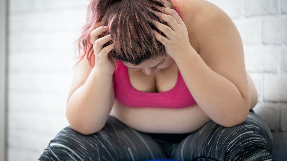 plus size asian girl feel upset when exercising