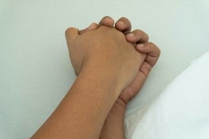 Couple holding hand isolated on white background