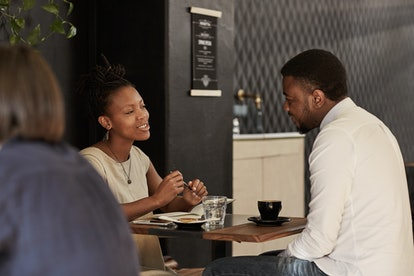 African couple enjoying coffee date in a modern cafe