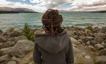 Rear view of a woman looking at lake, New Zealand