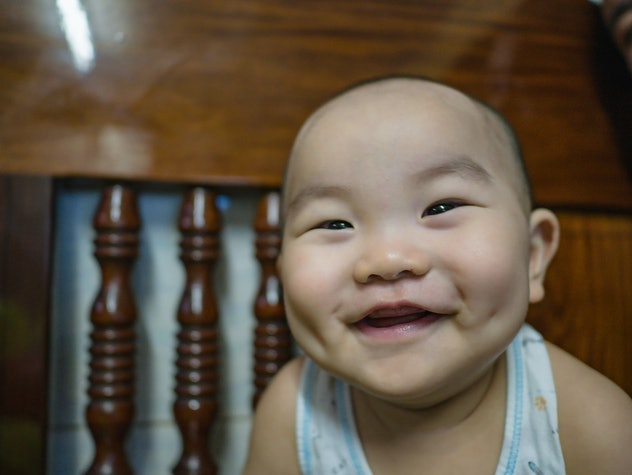 Asian boy baby or infant smile very happy