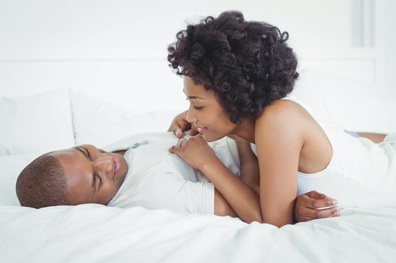 Happy couple lying on the bed and talking