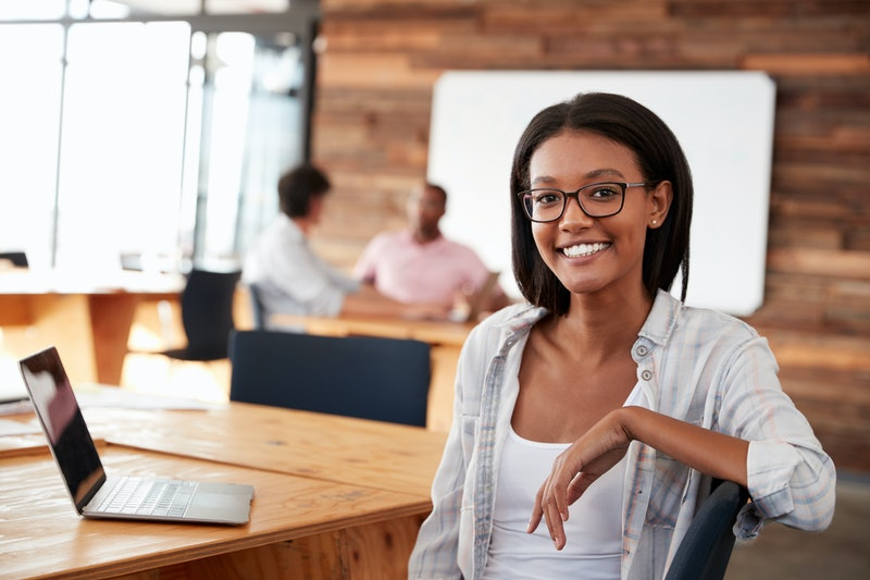 Portrait of young black woman in creative office