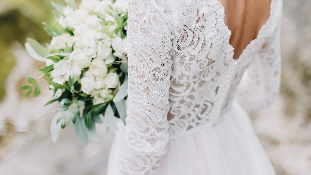 Bride holds a wedding bouquet, wedding dress, wedding details