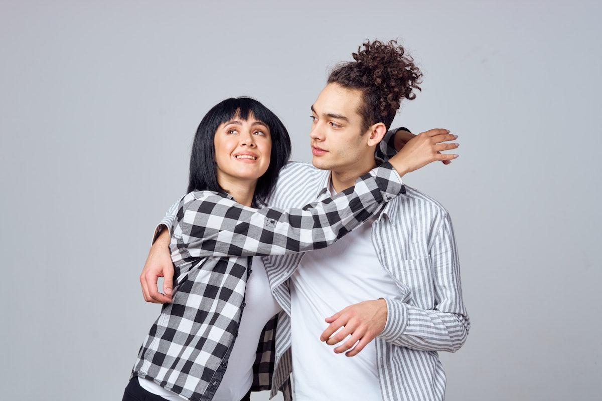 woman and man hug each other
