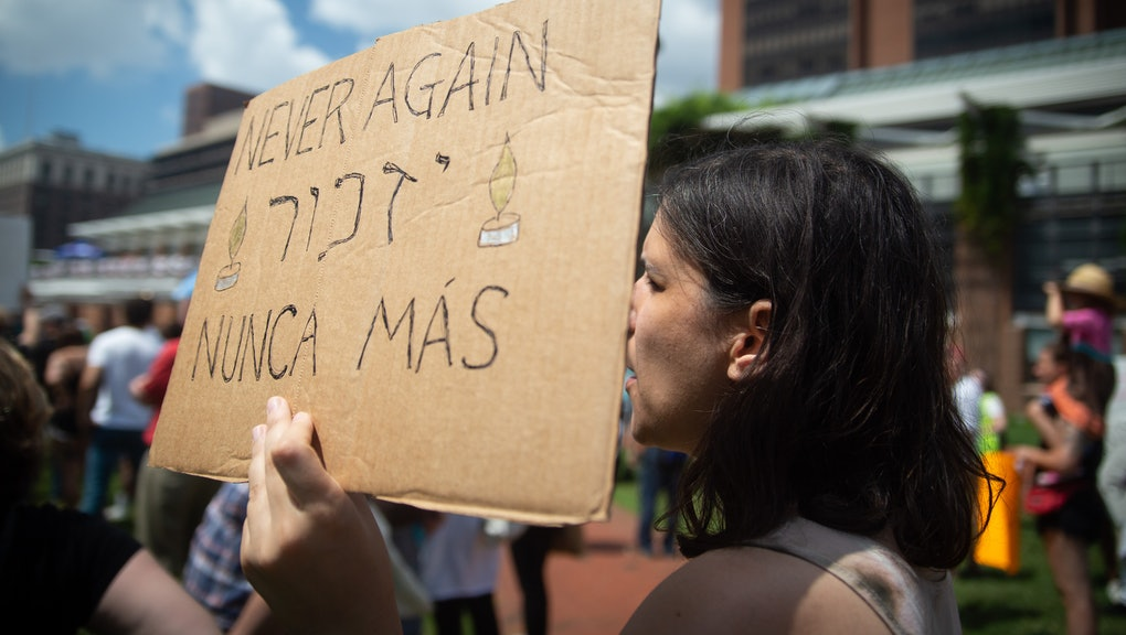 Protestors forming the 'Never Again is Now 'Never Again is Now' demonstration gather on Independence Mall during the city's Independence Day festivities.