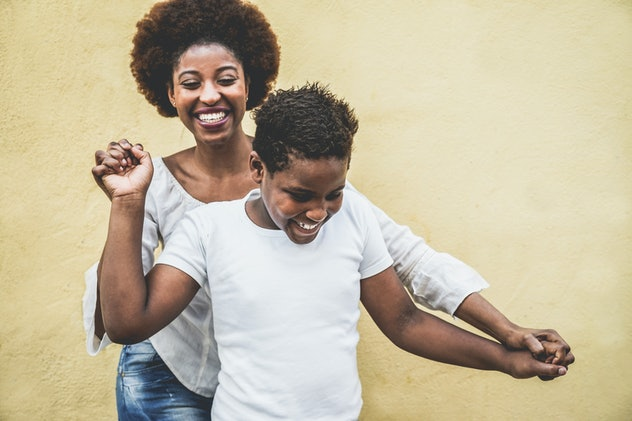 Happy young mother having fun with her child - Mom playing and dancing with his son - Family lifesty...