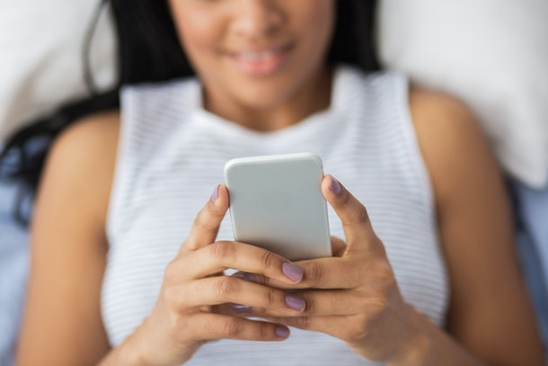 Close-up of woman texting sms on phone