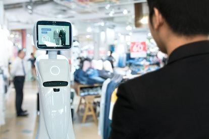 Robotics Trends technology , smart retail business concept. Autonomous personal assistant robot for ...