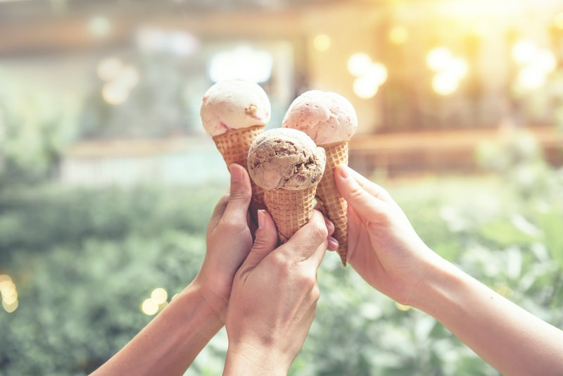 Young woman hands holding ice cream cones on summer