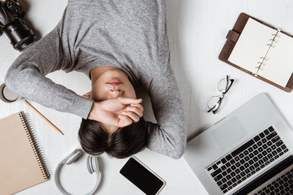 Top view of tired businessman at workplace with copy space