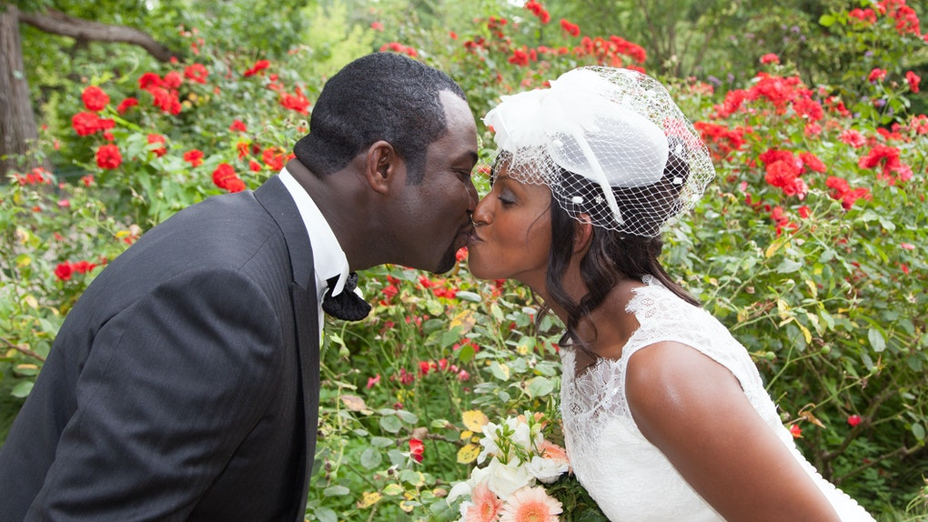 kiss between pretty wedding couple
