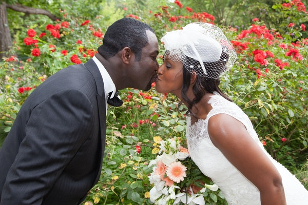 kiss between pretty wedding couple