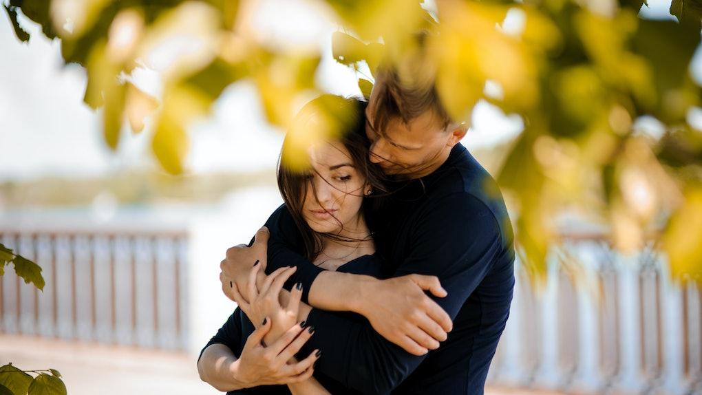 Man comforting his woman outdoor