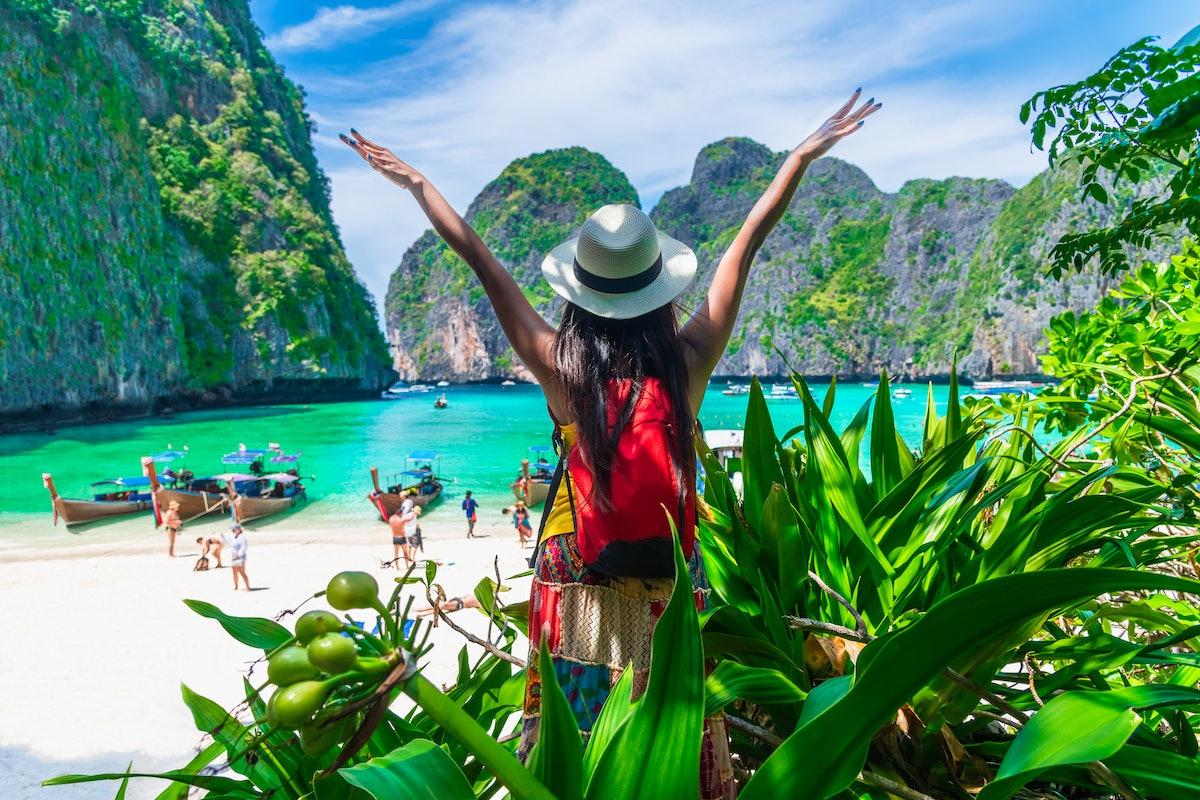Traveler woman joy fun on tropical beach forest look beautiful nature paradise beach Maya bay Krabi,...