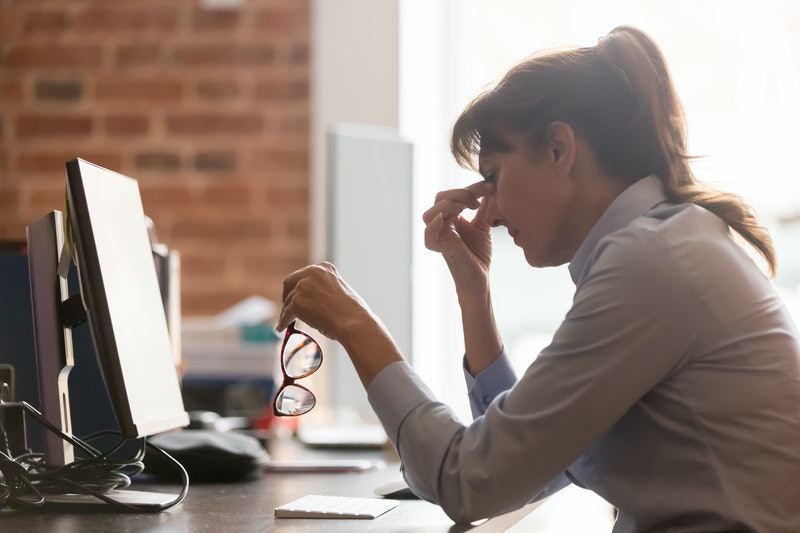 Stressed overworked middle aged businesswoman office worker taking off glasses tired from computer work feeling headache, dry eye strain, bad blurry weak vision eyestrain tension problem concept