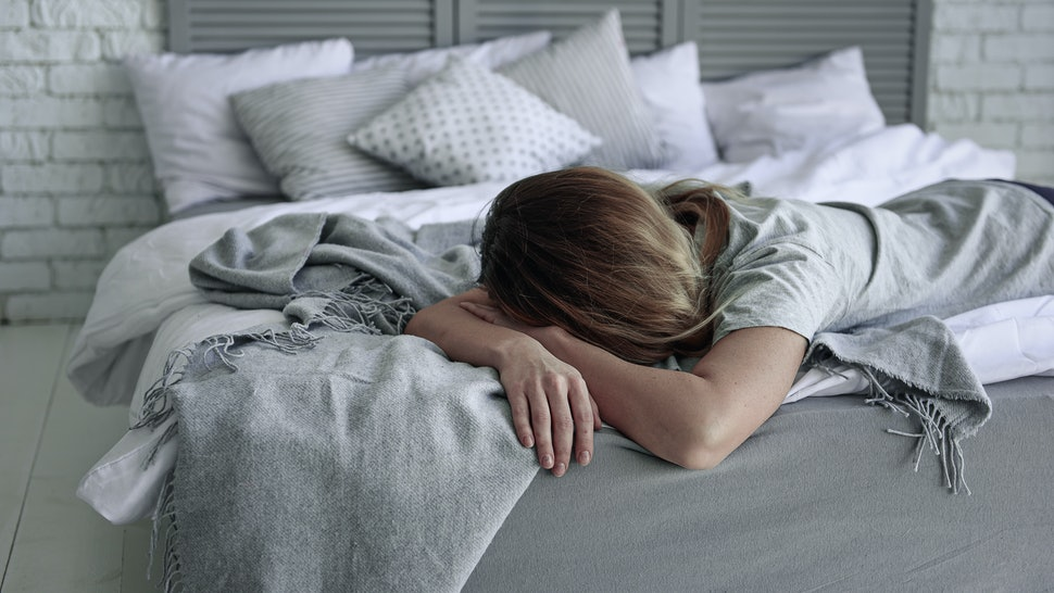 Deeply upset woman on bed