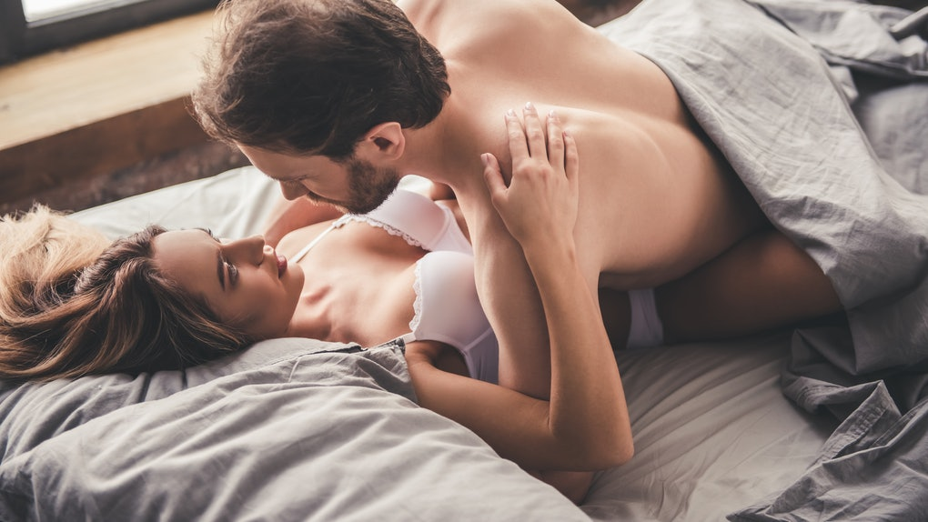 Beautiful couple is having sex in bed at home